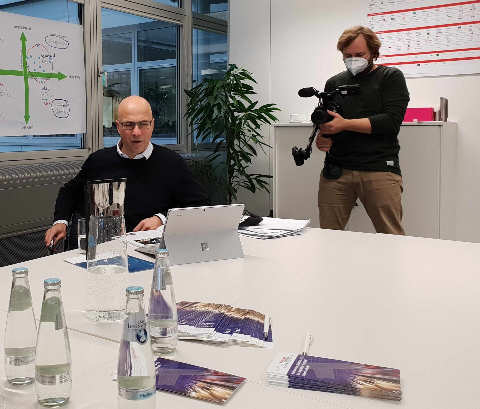 Joerg Welke about our Coordination and consultation meeting during the image film recording with cameraman in the background